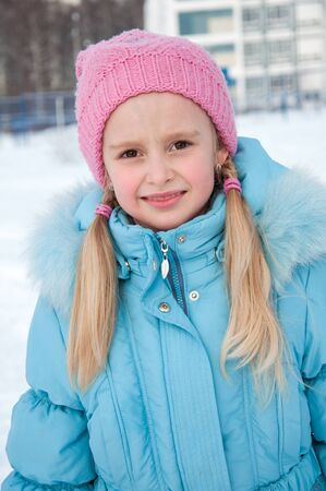 Portrait of a seven-year-girl in winter clothes photo
