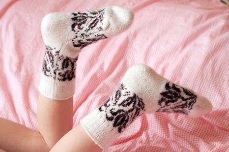 Childrens feet in wool socks photo