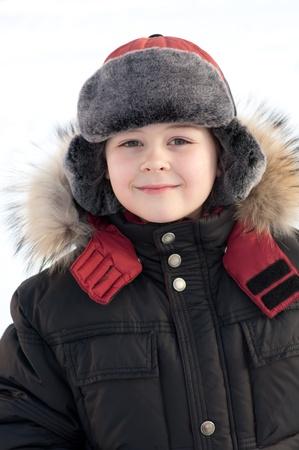 Portrait of a boy in a fur jacket