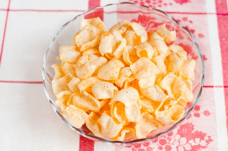 Tasty potato chips in a bowl Stock Photo - 12535835