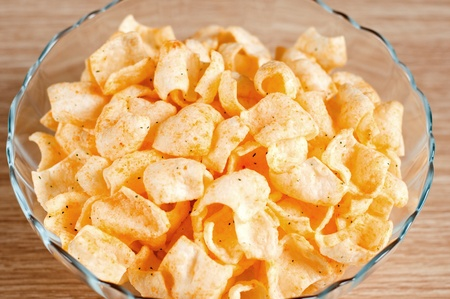 Tasty potato chips in a bowl Stock Photo - 12535837