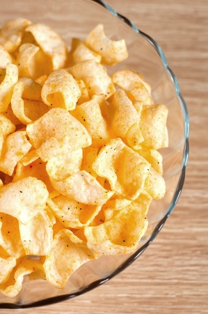 Tasty potato chips in a bowl Stock Photo - 12535836