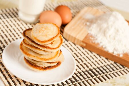 Home pancakes with sour cream, flour and eggs Stock Photo - 12895688