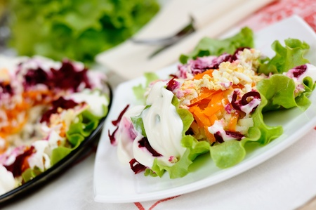 Salad with herring and vegetables photo