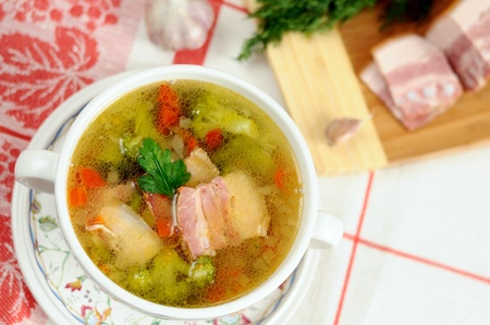 Italian soup with vegetables and bacon photo