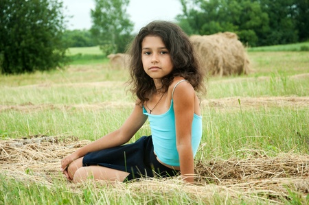 Beautiful long-haired girl in a field Stock Photo - 13376261