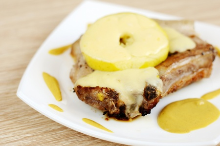 Beef steak with apple and cheese photo