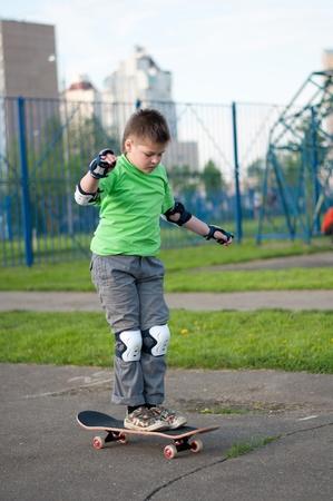 A boy riding a skateboard photo