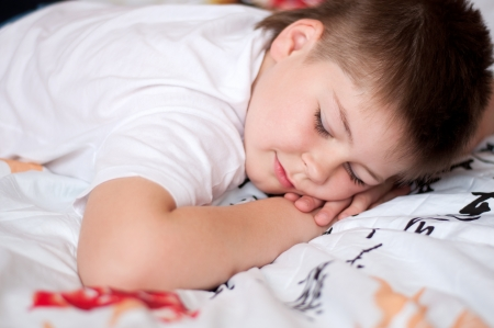 The boy was asleep on a pillow with Chinese characters Stock Photo - 13708836