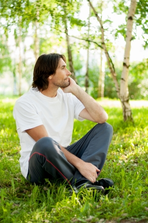 40 to 45 years old: Middle-aged man in a park