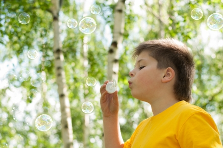 The boy blow bubbles at the park Stock Photo - 13875304
