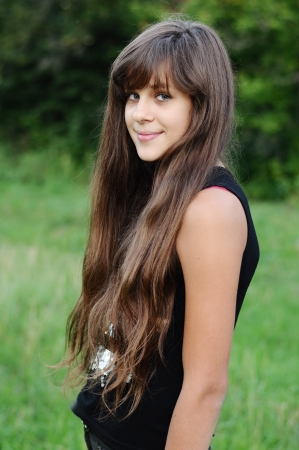 14 15 years: Brunette teen girl on nature