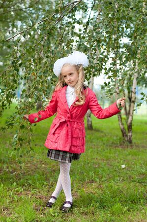 Schoolgirl dressed in a birch forest photo