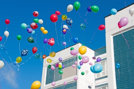 Colorful balloons on a blue sky background photo