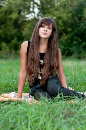 Brunette teen girl on nature Stock Photo - 15542930