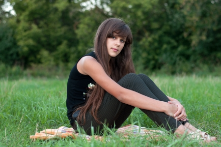 Brunette teen girl on nature Stock Photo - 15542926