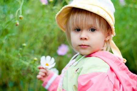 Little girl with flowers 2.5 years photo