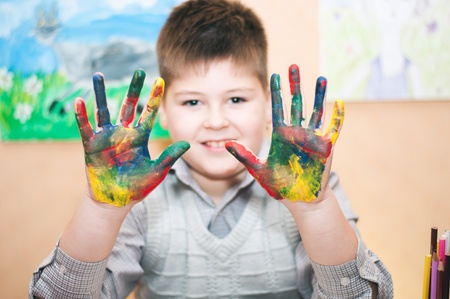 soiled: Boy with hands soiled in a paint