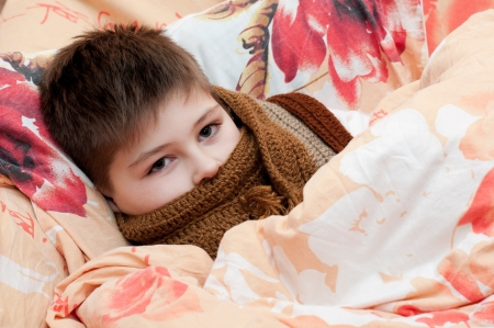 caucasian fever: Sick boy lying in bed