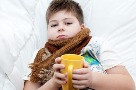 sick boy: Sick boy lying in bed