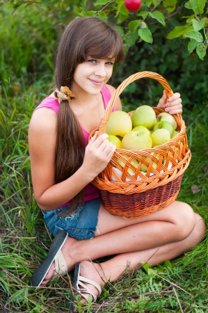 Teen girl with a basket of apples Stock Photo - 16637958