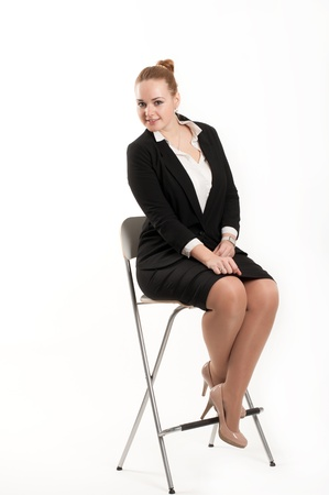 Business woman sitting on a high chair photo