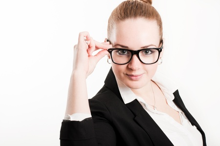 Business woman in glasses on a light background photo