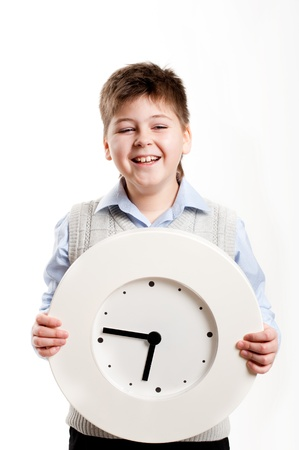 keep your hands: A boy with a clock on a light background