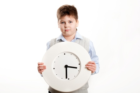 keep your hands: boy with a clock on a light background