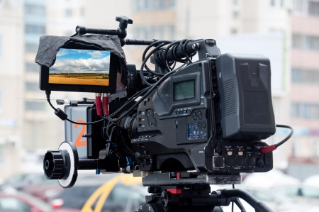 outside shooting: Professional video camera on a city street Stock Photo
