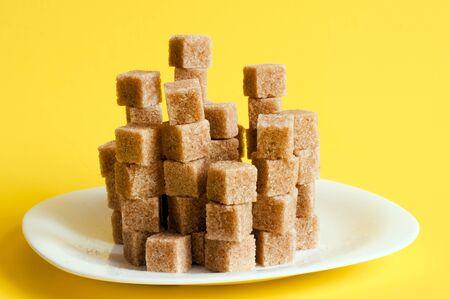 unrefined: Unrefined sugar on a yellow background