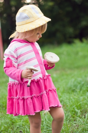 Little girl with white mushrooms Stock Photo - 18295165