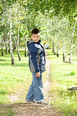 8 years old: The boy is on a path in the park