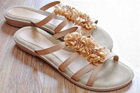 Ladies beige sandals low heels Stock Photo - 18626845