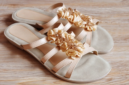 Ladies beige sandals low heels photo
