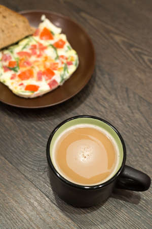 Breakfast - scrambled eggs and coffee photo