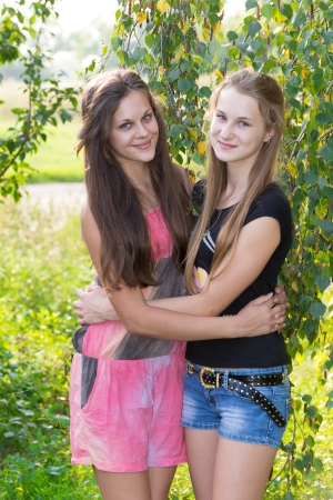 two teenage girls near birch photo