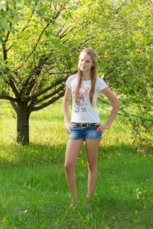 Girl in apple orchard in summer