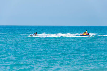 tourists on watercraft with jet ski