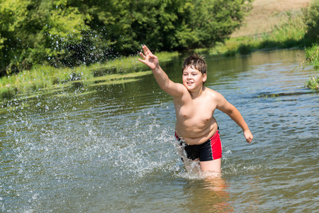 Full 10 years boy swim in the river