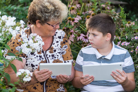 internet explorer: Grandma with a grandson watching tablet PC Stock Photo