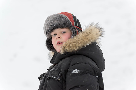 sledging people: Teenage boy playing in the snow in winter Stock Photo
