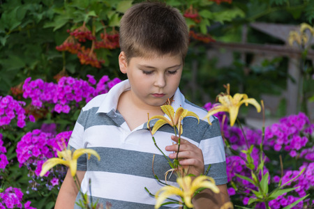 grand sons: Teen boy about flowers in the garden