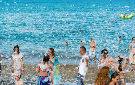 foam party: Kemer, Turkey-August 21, 2014. Foam Party on a resort. Group of people enjoying in drinking, dancing and music.