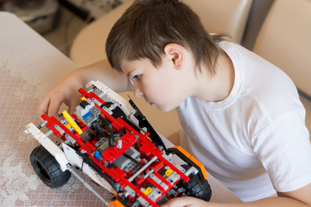 A boy plays collects from the constructor of the car