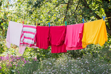laundered: Linen is dried on a rope in the garden