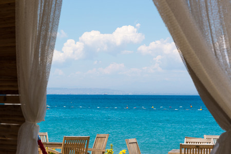 A view of the sea from the window of the House photo
