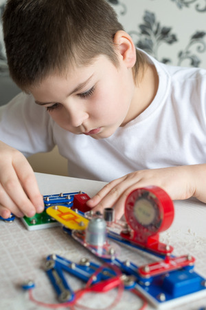 pre school: a Teen boy at home with electronic project Stock Photo