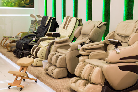A Beige massage chairs in the store