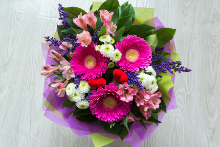 A bouquet of flowers with a gerbera